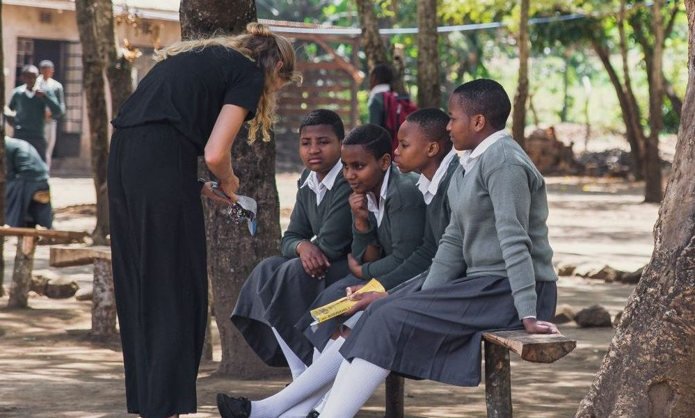 Elissa teaching young female students about reusable pads