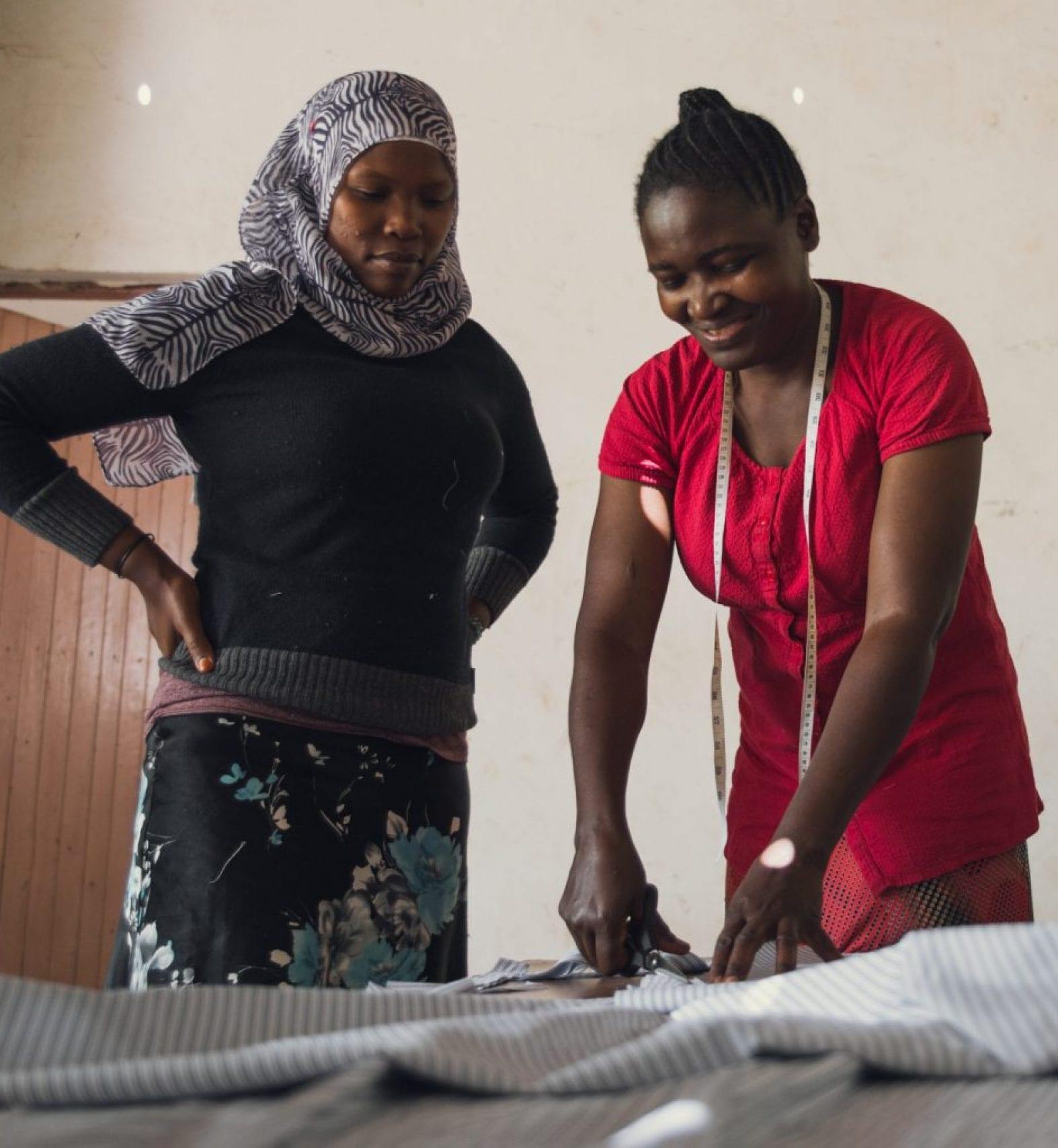 Mama Ismael and Mama Glory - Cutting fabric for underwear.